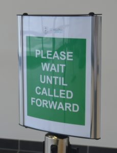 Security sign - white text on green background