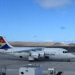 Photograph of the SA Airlink charter aircraft on the apron at St Helena Airport