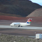 Photograph of the SA Airlink charter aircraft taxi on Runway 20 at St Helena Airport for take-off