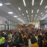 First scheduled commercial flight - crowds in the Terminal Building to welcome the first passengers