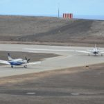 Two Daher TBMs turning onto the runway at St Helena Airport in readiness for departure