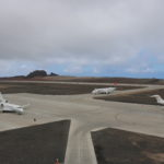 Photograph of three aircraft on the apron at St Helena Airport as viewed from the Control Tower building