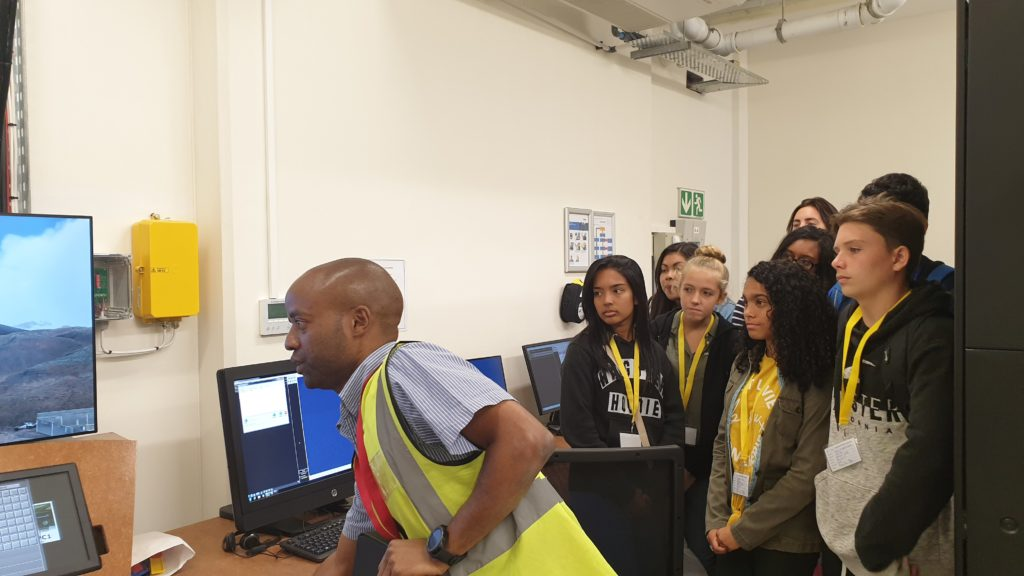 BASH visit to St Helena Airport - photo of air traffic control simulator with ATC Officer and BASH young people