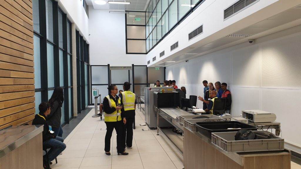 Photo of BASH young people viewing security processes at St Helena Airport
