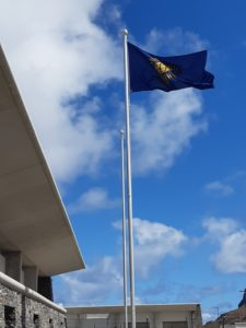 Photograph of the Commonwealth Flag flying at St Helena Airport on the 2020 Commonwealth Day