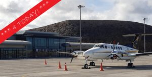 Photo of King Air aircraft registration ZS-TAE in front of the Terminal Building at St Helena Airport