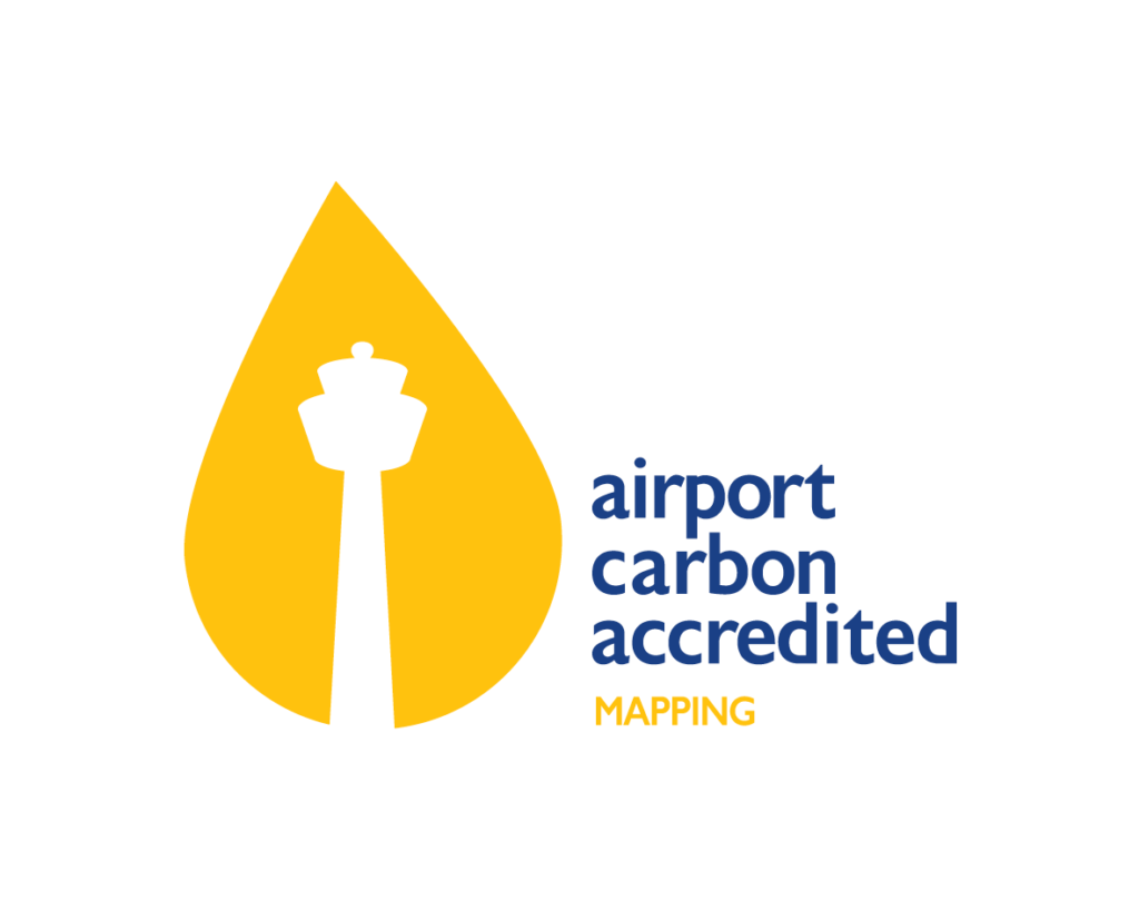 Airport Carbon Accreditation mapping logo - silhouette white control tower against a large yellow leaf